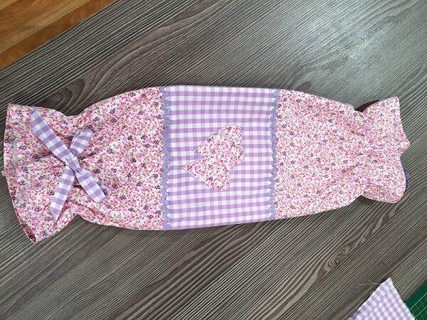 Puxa saco de tecido patchwork nas cores rosa e lilás