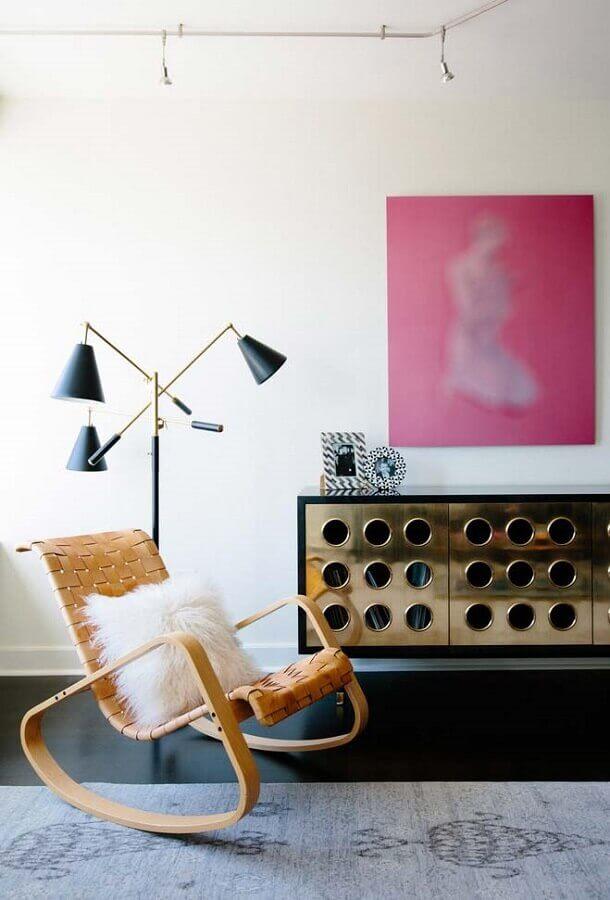 sala decorada com cadeira de balanço Foto ProDesign