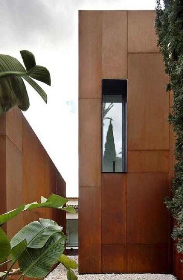 casa com paredes externa em revestimento aço corten  Foto Architizer