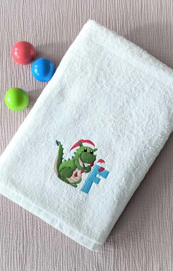 toalha de banho bordada com estampa infantil Foto Pinosy