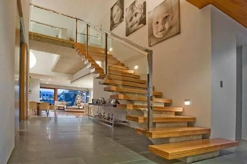 casa com mezanino e guarda corpo de vidro Foto André Arquimagens
