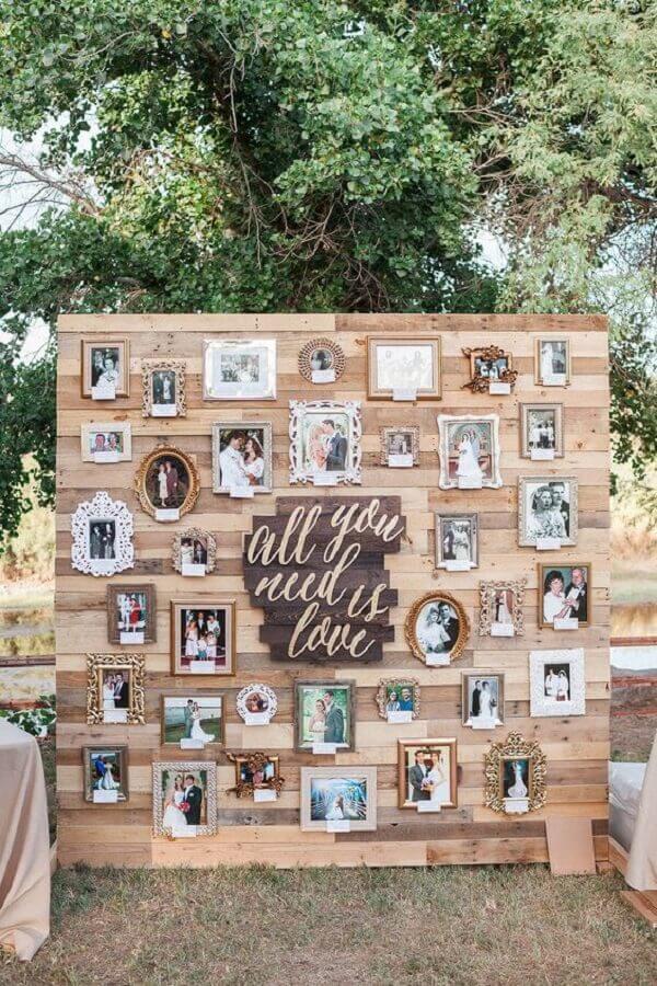 decoração bodas de pérola com mural de fotos  Foto Hasshe