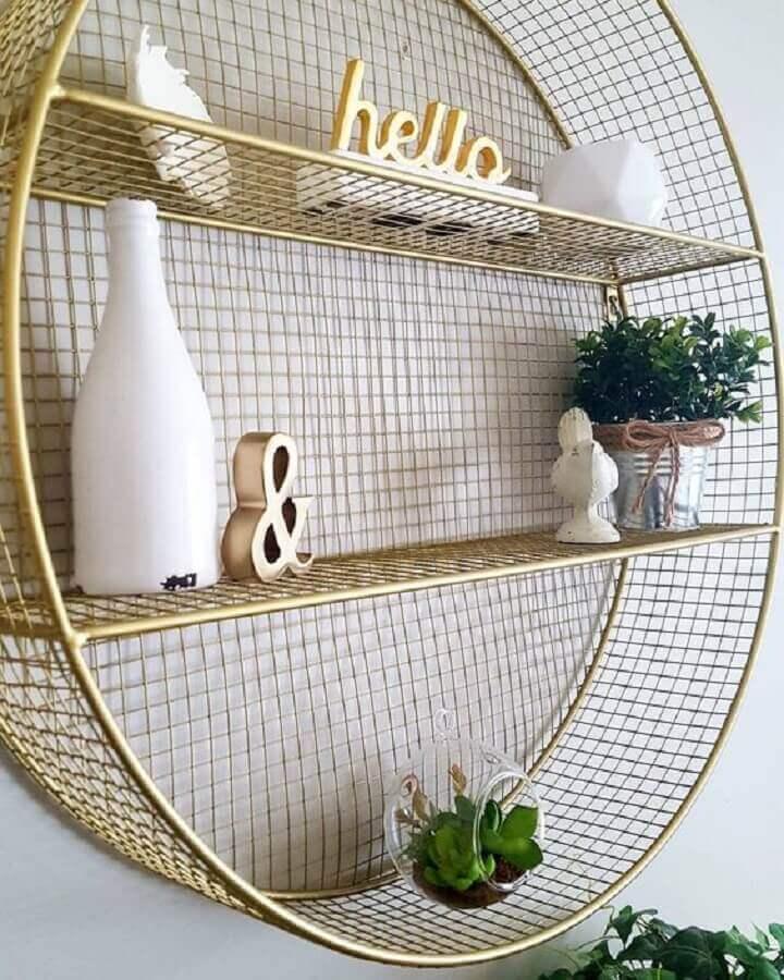 modelo de nicho redondo com aramado dourado Foto Pinosy
