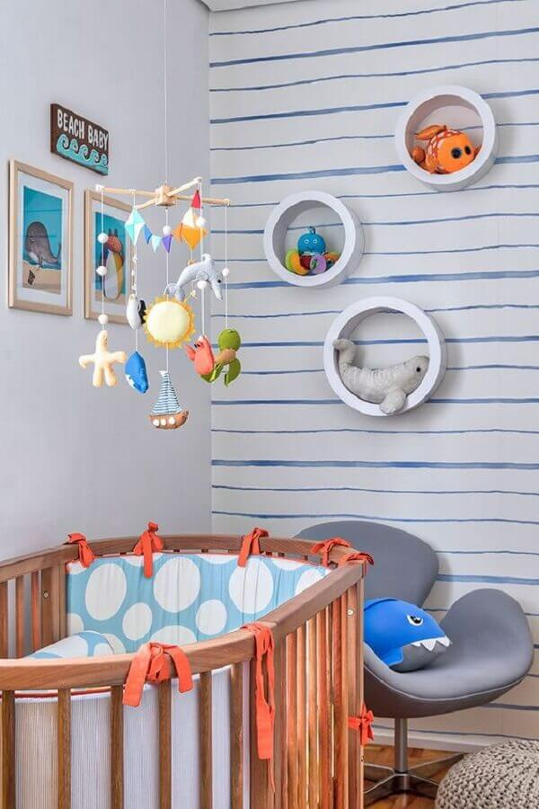 nicho redondo para quarto de bebê decorado com tema fundo do mar Foto Doob Arquitetura
