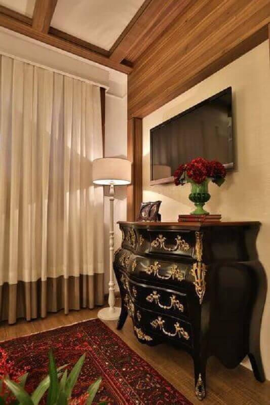 cômoda vintage preta com detalhes dourados Foto Majó Arquitetura de Interiores