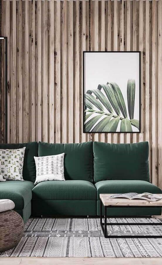 decoração simples com quadro tumblr para sala com sofá verde Foto Behance