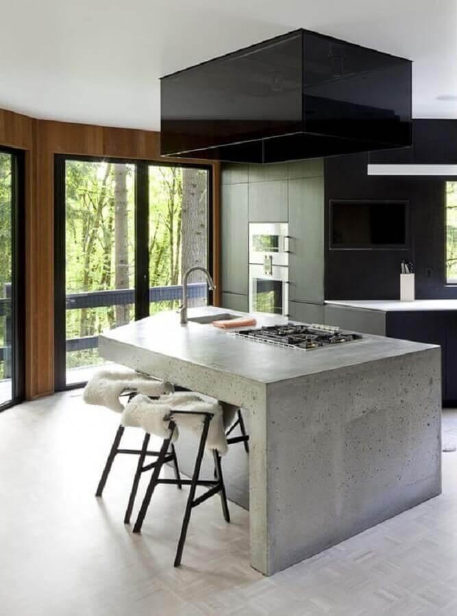 cozinha moderna com bancada de concreto e cooktop Foto Pinterest