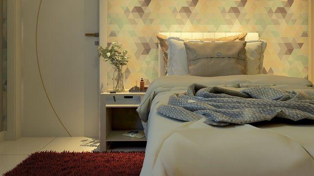 papel de parede geométrico - quarto de solteiro com papel de parede geométrico colorido