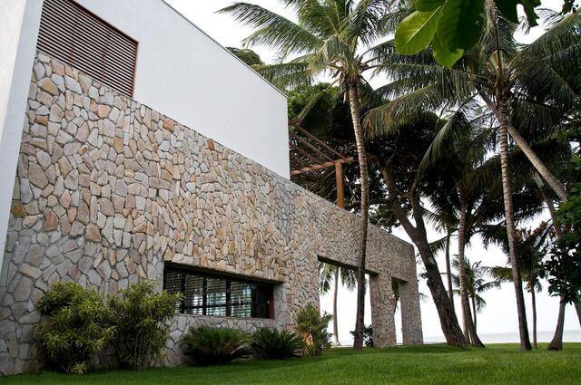 parede de pedra - parede de pedra em fachada moderna