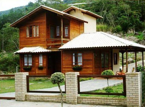 casas de madeira - casa de madeira com portão