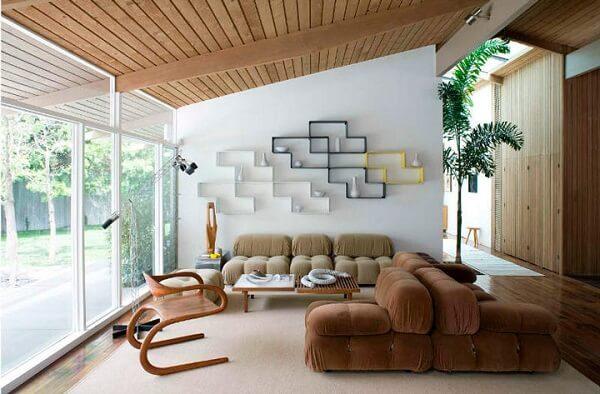 Os nichos para sala podem formar uma linda obra de arte na parede