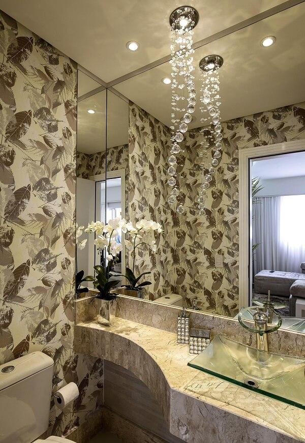 pia de banheiro de vidro com lustre