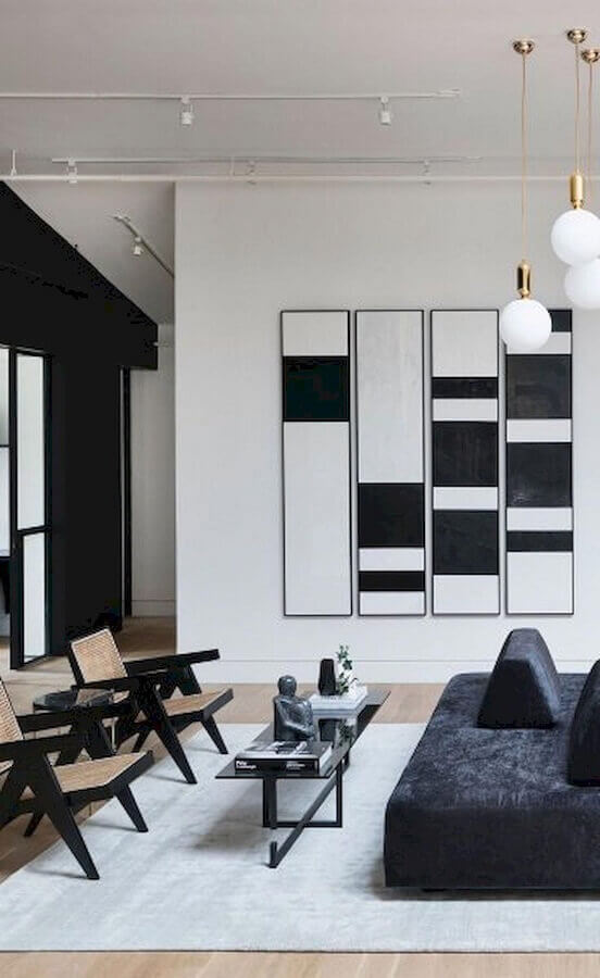 sala moderna preta e branca decorada com quadros decorativos abstratos  Foto Pinterest