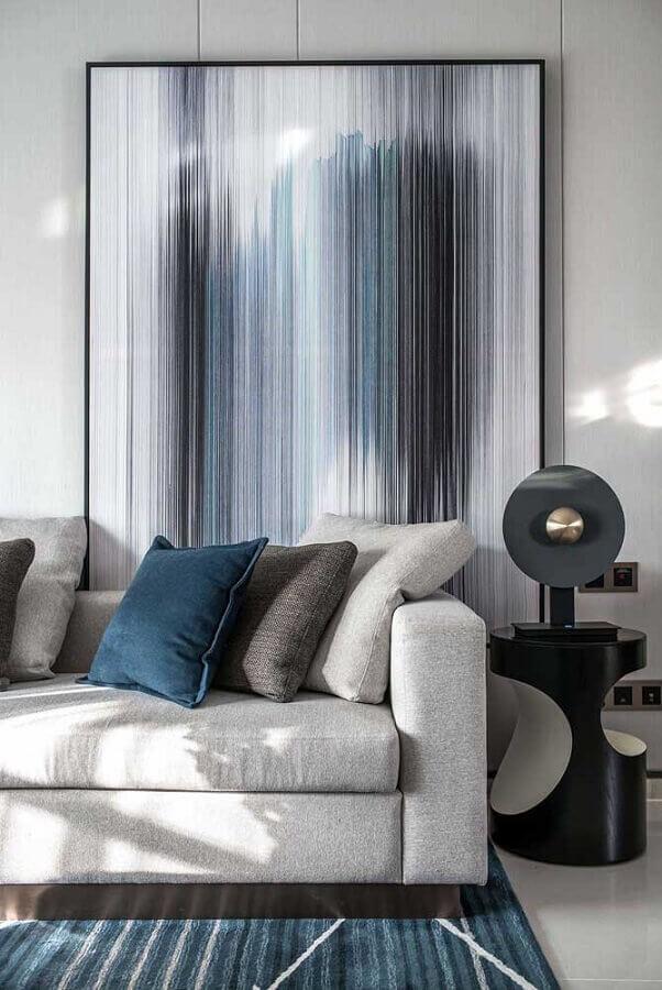 decoração de sala com mesa de canto preta redonda moderna  Foto Behance