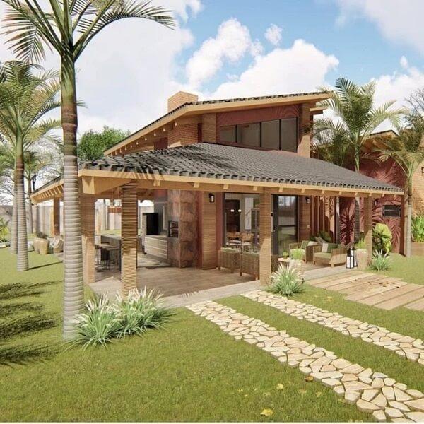 As pedras e tijolinhos fazem parte da decoração de diversos projetos de casas de campo com varandas