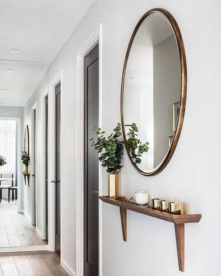 decoração de corredor com espelho de parede redondo Foto Pinterest