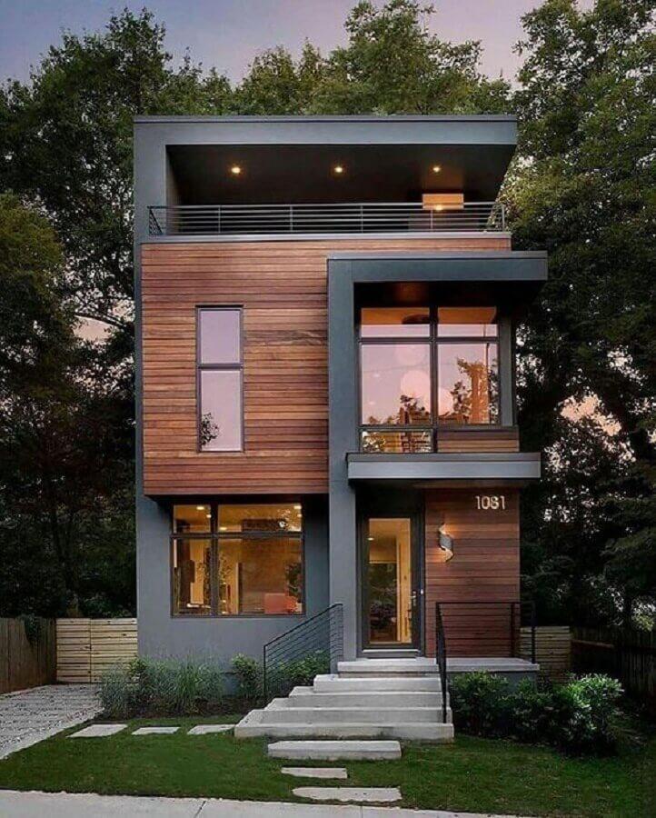 fachadas de casas em tons de cinza com detalhes em madeira  Foto Pinterest
