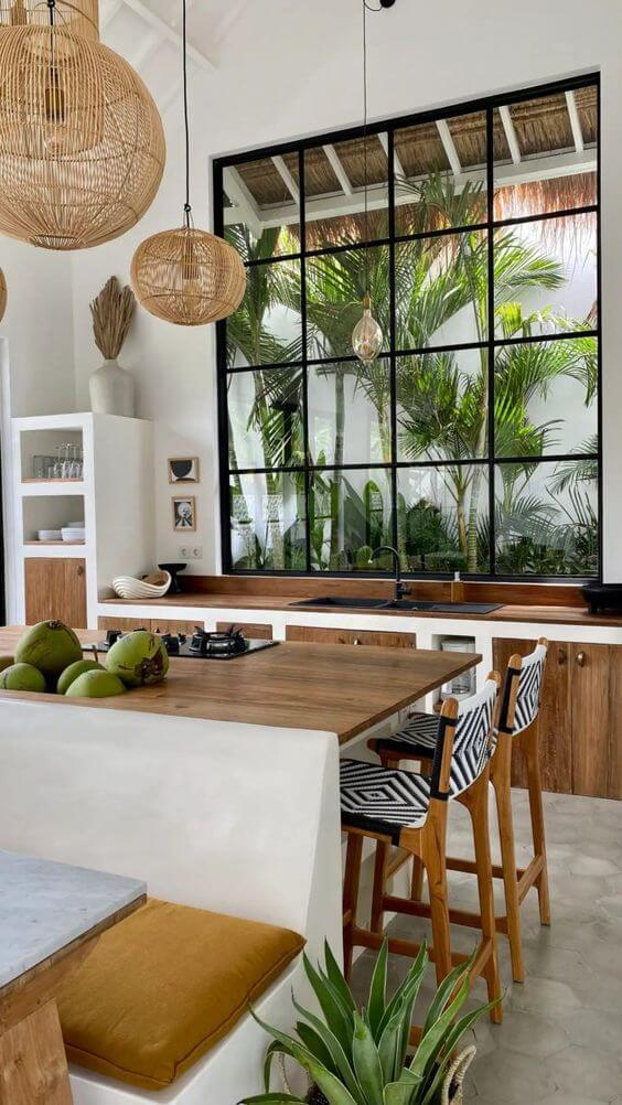 Lustre rústico na cozinha branca e clean
