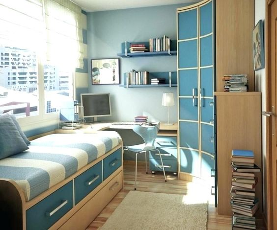 Quarto infantil planejado com armário de canto na cor azul