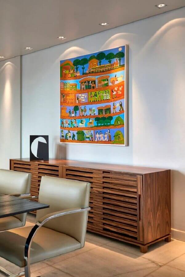 balcão buffet de madeira para sala de jantar decorada com quadro colorido Foto Homify