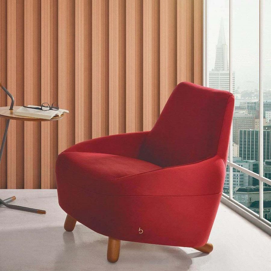 escritório decorado com poltrona vermelha confortável Foto Bell'arte Living