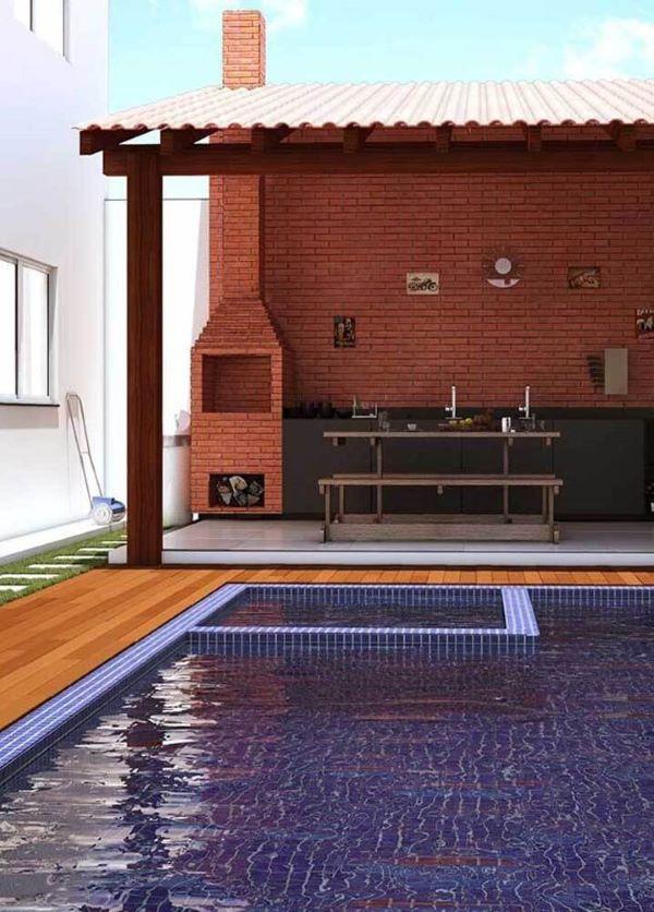 Área da piscina com chaminé de Churrasqueira de tijolinho pequena acima da cobertura