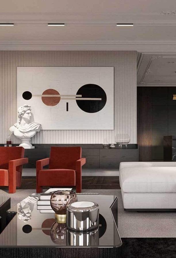 sala de estar cinza moderna decorada com cadeira vermelha Foto Pinterest