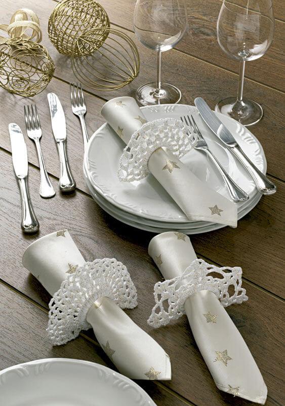 Guardanapo prata com estrelas douradas para decoração de mesa de Ano Novo Foto Circulo