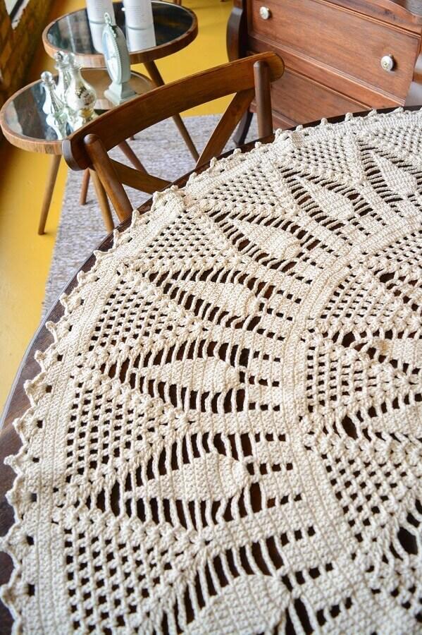 Decoração com toalha de mesa redonda de crochê Foto Circulo